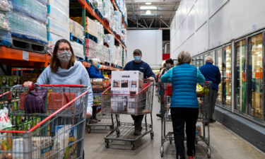 Shoppers wearing masks search for items at a Costco Wholesale store on February 26 in Colchester