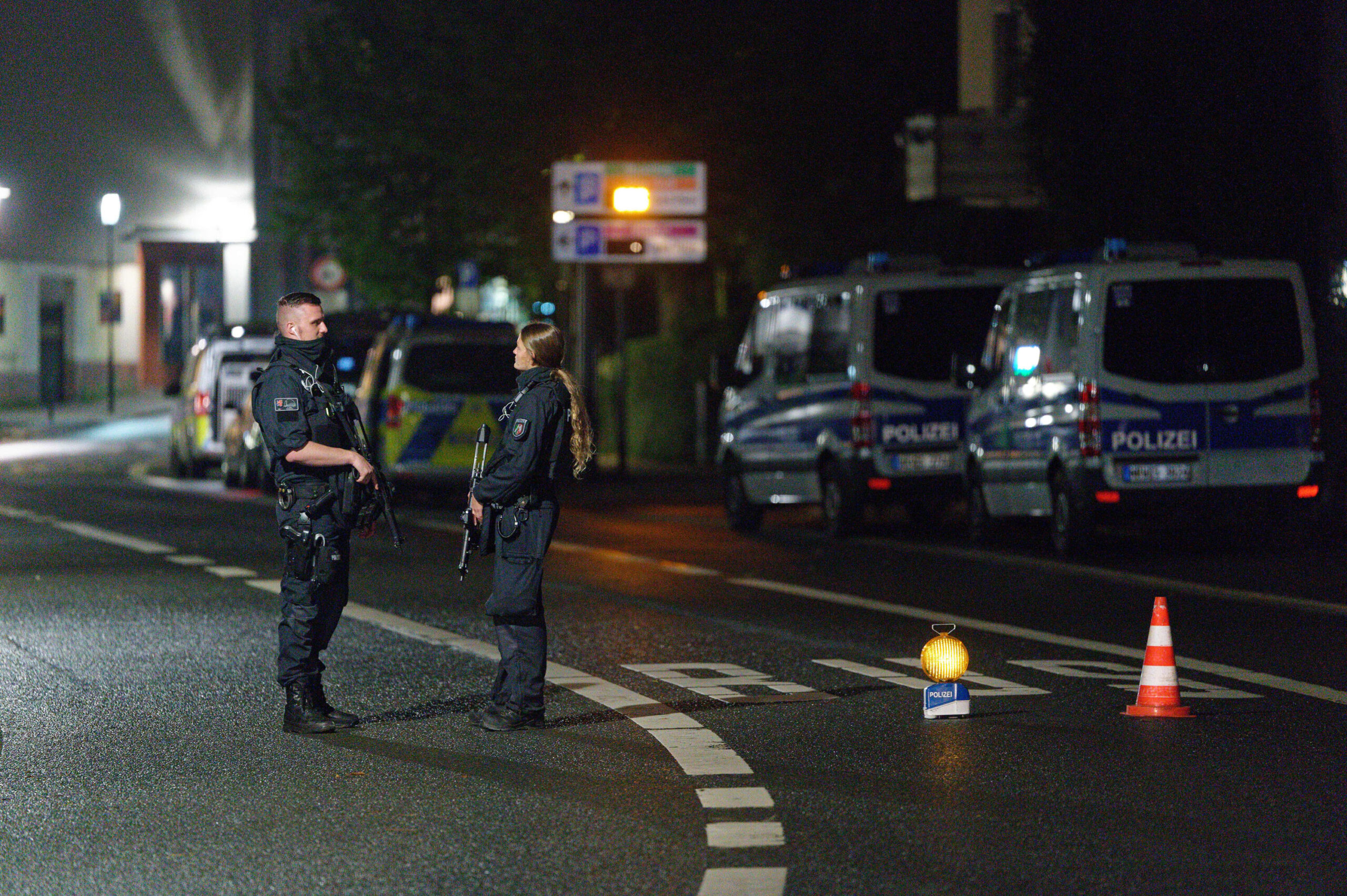 <i>Henning Kaiser/picture alliance/Getty Images</i><br/>Police officers block a street in Hagen on Wednesday evening after warnings of a terror threat against a synagogue.