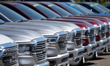 A lone line of unsold 2021 pickup trucks in an empty storage lot at a Dodge Ram dealership on Sept. 12 in Littleton