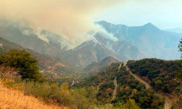 A pair of wildfires burning in California's parched Sierra Nevada mountains