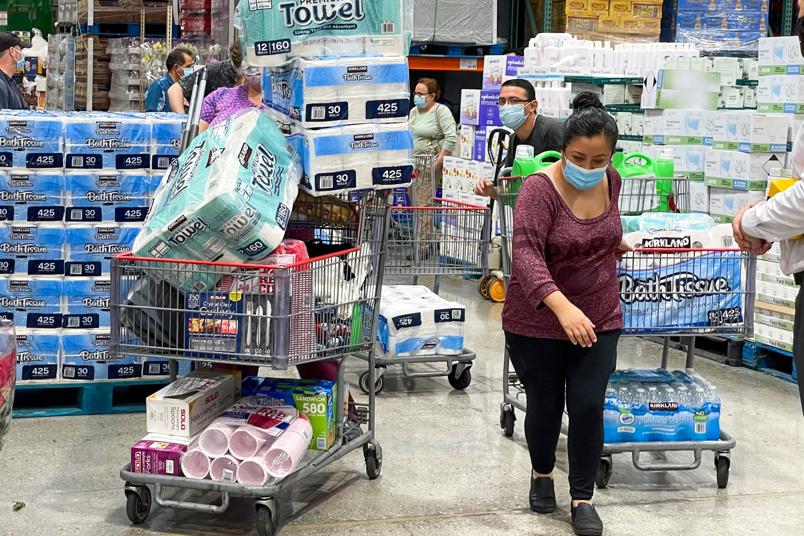 <i>Ringo Chiu/AP</i><br/>People buy toilet papers and paper towels at a Costco Wholesale store as panic buying following the coronavirus disease outbreak in Alhambra