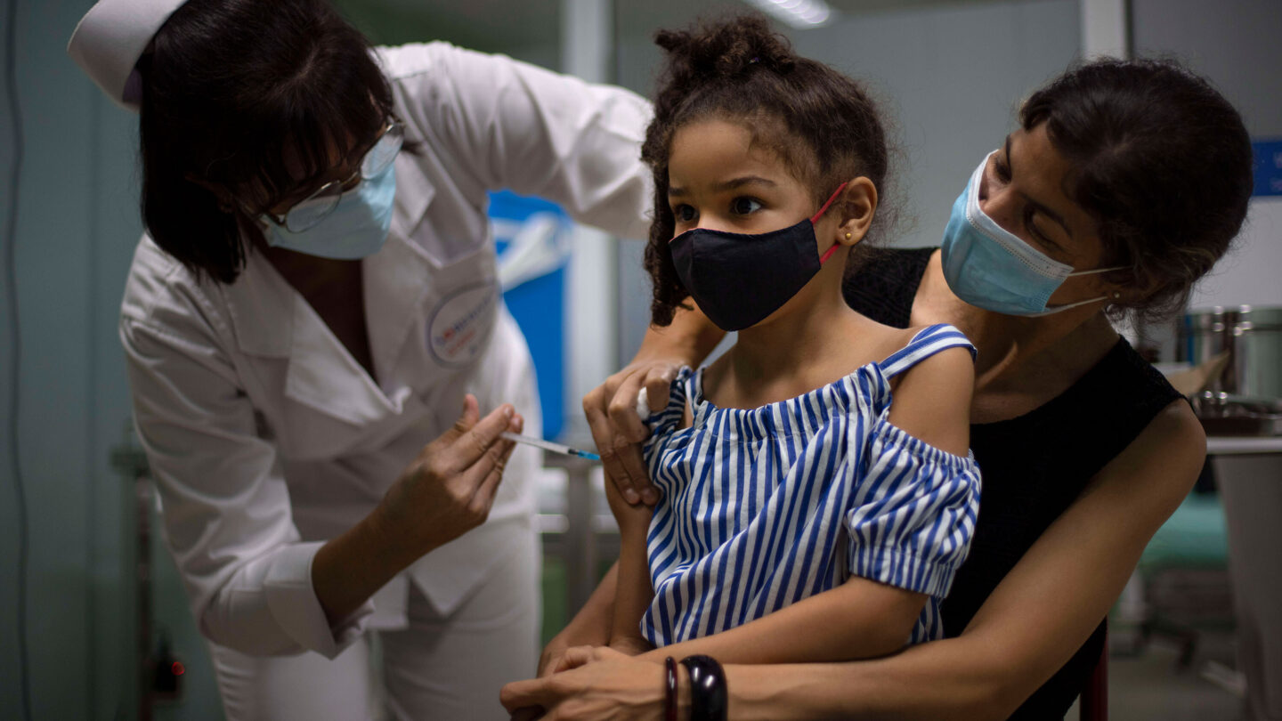 <i>Ramon Espinosa/AP</i><br/>A girl gets a dose of the Cuban-made Soberana-02 vaccine in Havana on August 24.