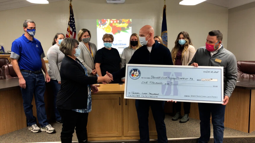 Jeremy Taylor School Lunch Project presents check