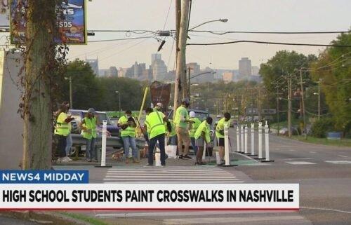 Nashville high school students install glow-in-the-dark crosswalks on October 24.