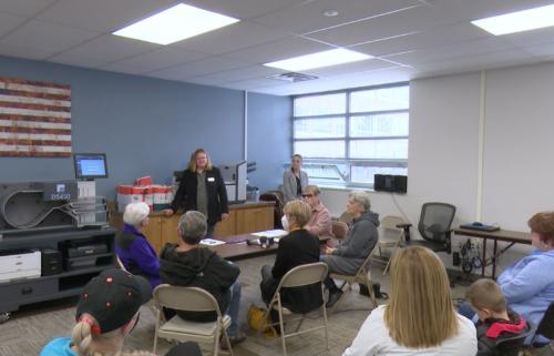 Election's Administrator Julie Hancock demonstrates election process