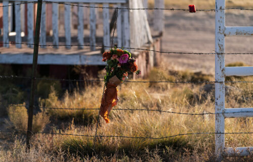 A bouquet of flowers honoring cinematographer Halyna Hutchins outside the Bonanza Creek Ranch in Santa Fe