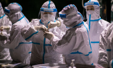 Authorities in northern China are reimposing lockdowns and other emergency measures to curb the spread of coronavirus. Medical workers are shown here working on the samples of Covid-19 nucleic acid test at a testing site in Hohhot