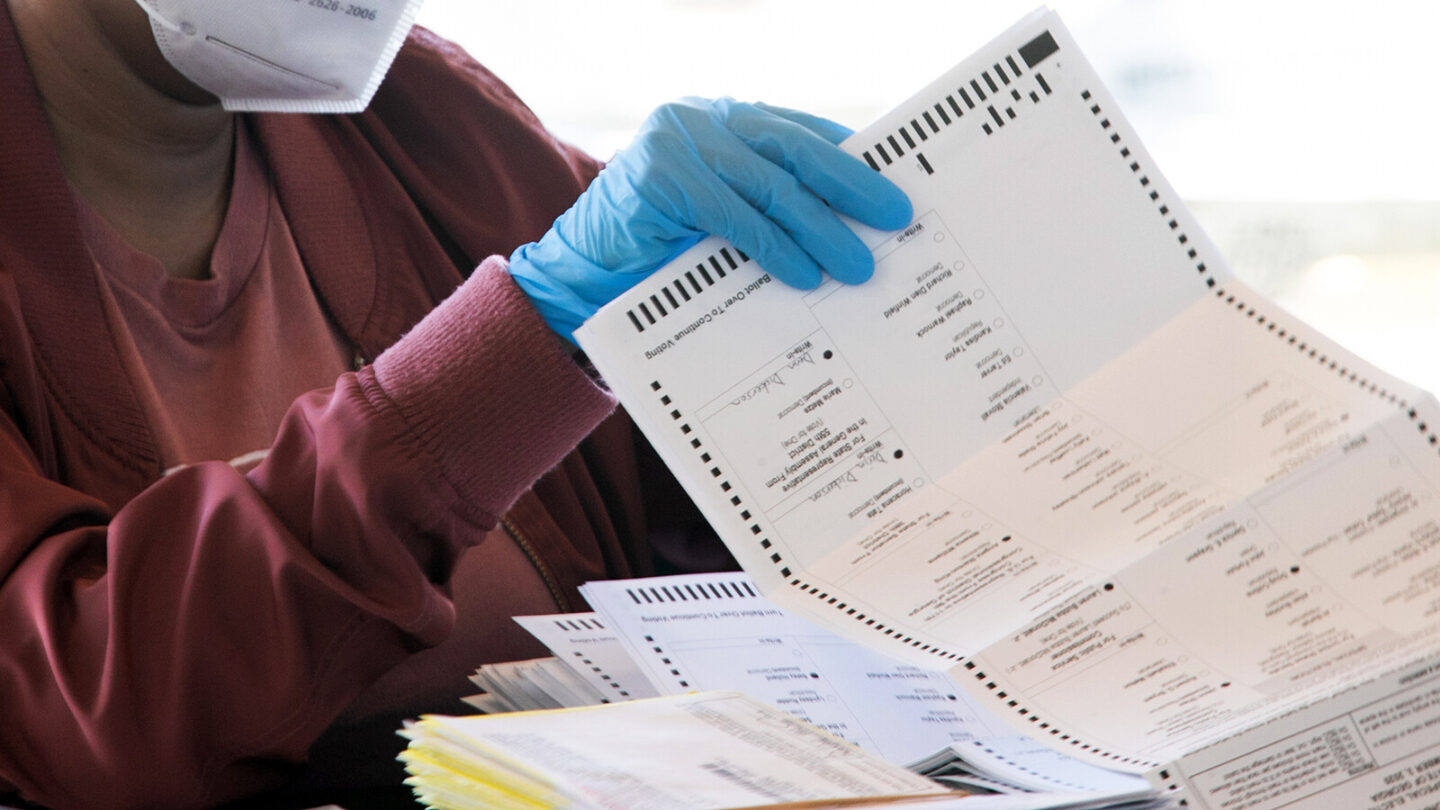 <i>Jessica McGowan/Getty Images/FILE</i><br/>An election worker counts Fulton County ballots on November 4