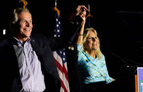 First lady Jill Biden laughs with Democratic gubernatorial candidate Terry McAuliffe during a rally in Richmond
