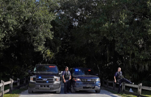 North Port police officers block the entrance to the Myakkahatchee Creek Environmental Park on Wednesday.