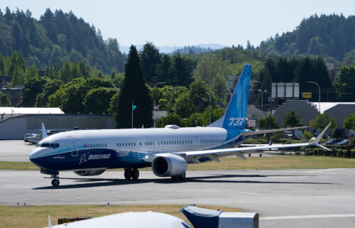 Boeing's quarterly results released Wednesday show the company is still facing a host of problems. Pictured is a Boeing 737 MAX preparing to take off on June 18