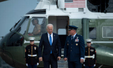 President Joe Biden on Thursday is expected to face questions about his legislative agenda and his handling of key issues during his first year in office when he participates in a CNN town hall in Baltimore. Biden is seen here at Joint Base Andrews in Maryland on October 15
